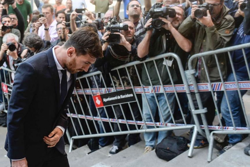 Barcelona's football star Lionel Messi arrives at the courthouse on June 2, 2016, in Barcelona, where he and his father face judges in a tax fraud case.