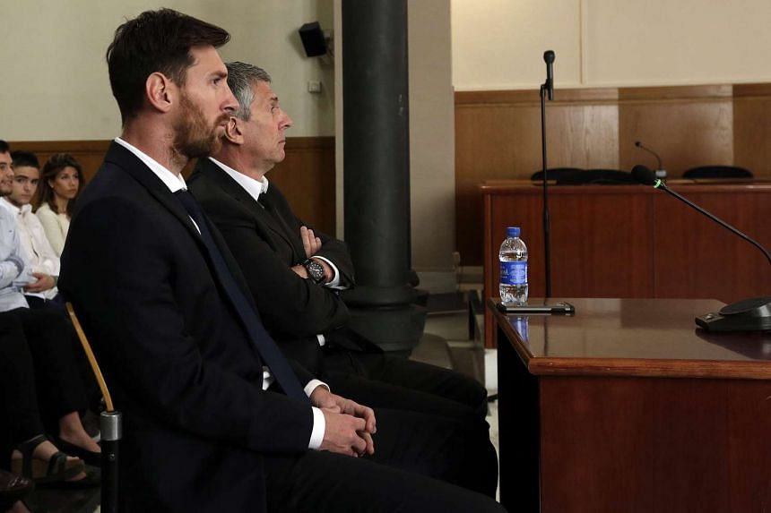 Lionel Messi (left) and his father, Jorge Horacio Messi, attend a session of their trial, on June 2, 2016.