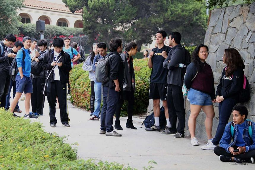 Students gather together during a lockdown at the University of California at Los Angeles campus.