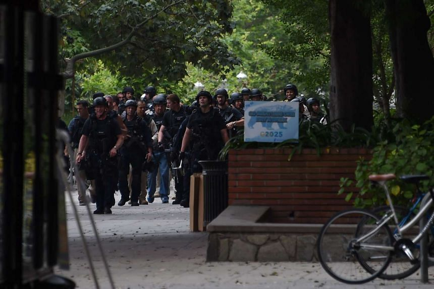 Police and other security search the area on June 1, 2016, at the University of California's Los Angeles campus.