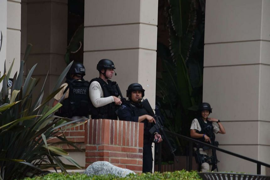 Security members are seen on June 1, 2016, at the University of California's Los Angeles campus.