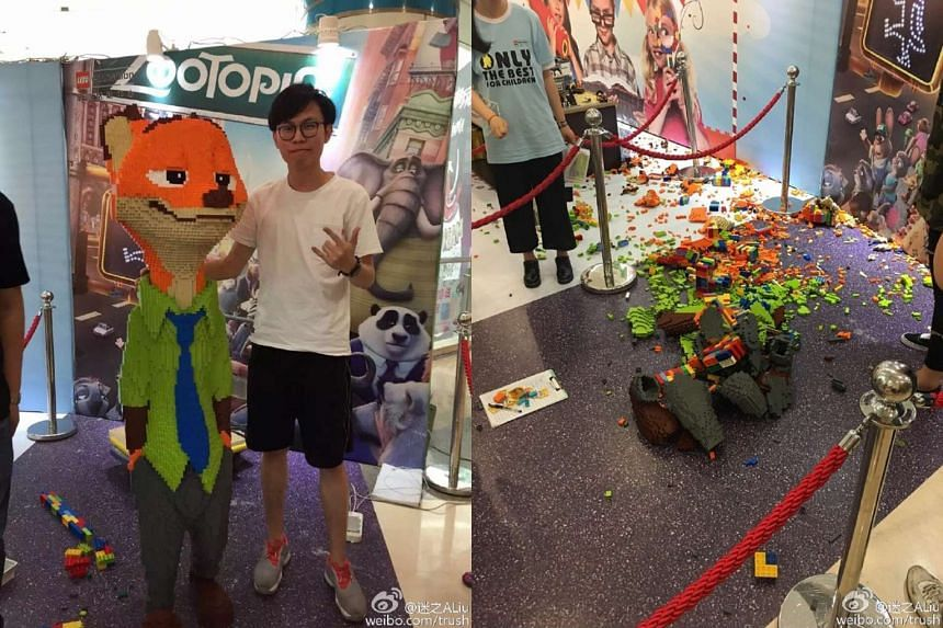 Mr Zhao posing with his Lego sculpture, which was smashed to pieces by a Chinese boy on Sunday (May 29).
