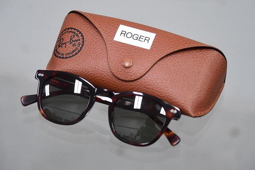 The Ray-Ban sunglasses worn by Roger Sterling is displayed among items from the American drama series Mad Men at ScreenBid.