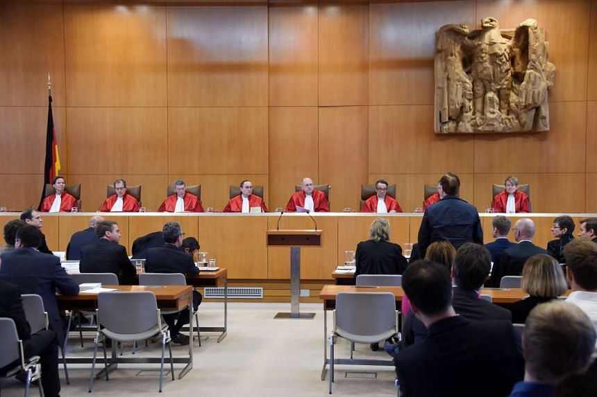 "This file photo taken on Nov 25, 2015, shows German musician Ralf Huetter (right) of band ""Kraftwerk"" waiting at Germany's highest court in Karlsruhe."
