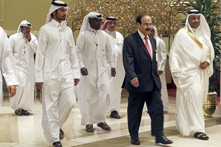 Bahrain's Minister of Energy Abdul Hussain bin Ali Mirza arrives to a meeting between OPEC and non-OPEC oil producers, in Doha.
