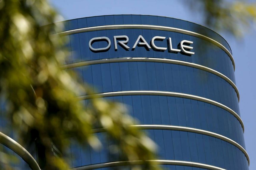 The Oracle logo is seen on its campus in Redwood City, California.