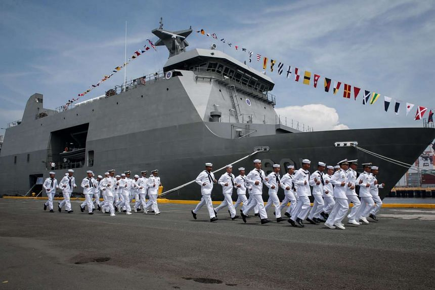 Filipino navy personnel run past the BRP Tarlac during the Philippine Navy's 118th anniversary at a port in Manila. The Philippines has an ongoing conflict with China over territories in the South China Sea.