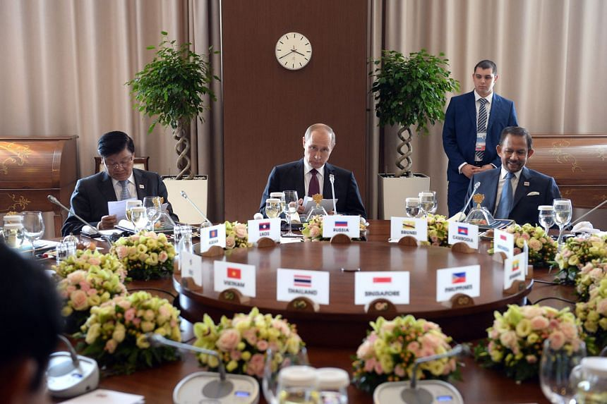 Mr Putin (centre) at a working breakfast with leaders attending the Asean-Russia Summit in Sochi. Seated beside him are Prime Minister of Laos Thongloun Sisoulith (left) and Sultan Haji Hassanal Bolkiah of Brunei.