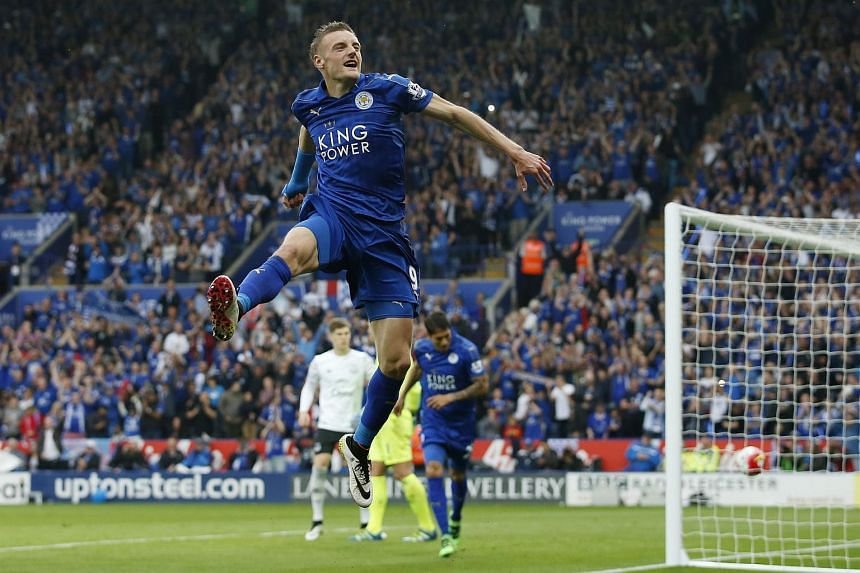 Jamie Vardy celebrates after scoring the third goal for Leicester City against Everton during a Barclays Premier League football match.