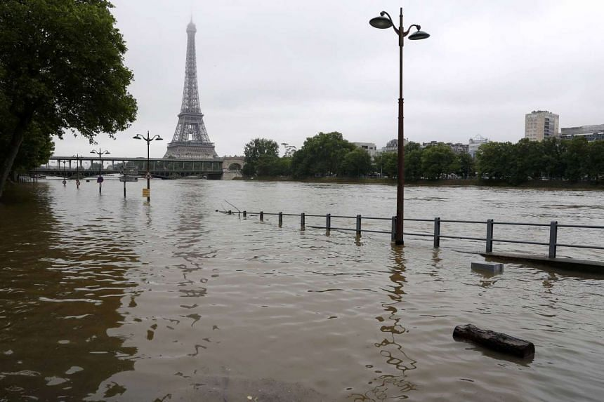 The river Seine overflowing its banks after days of non-stop rain caused flooding, near the Eiffel Tower in Paris, on June 3, 2016.
