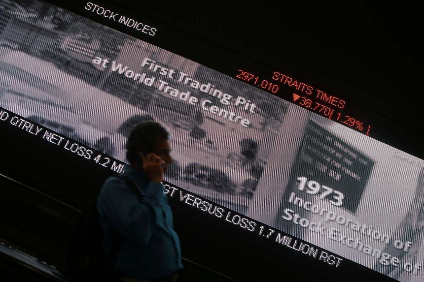 Display of the Straits Times Index (STI) on a ticker board in SGX Centre after the market closed on Aug 21, 2015.