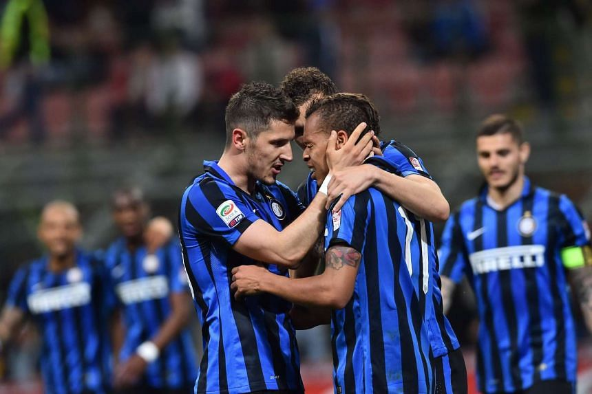 Inter Milan's midfielder Stevan Jovetic celebrates with teammates after scoring in the Serie A football match against Udinese in Milan, on April 23, 2016.