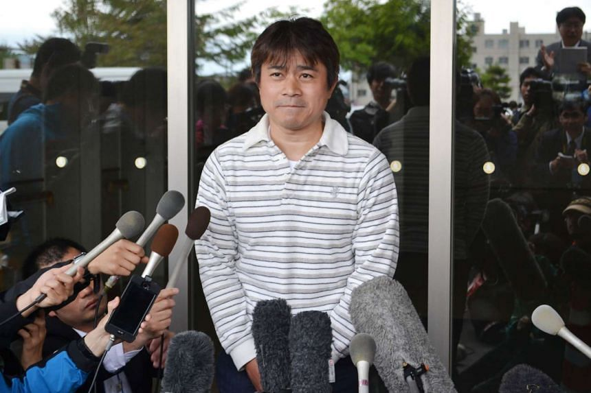 Mr Takayuki Tanooka, father of Yamato Tanooka, a seven-year-old boy missing since being abandoned in a bear-inhabited forest in northern Japan, speaks to reporters in Hakodate on June 3, 2016.  The boy, apparently unharmed and in good health, was dis