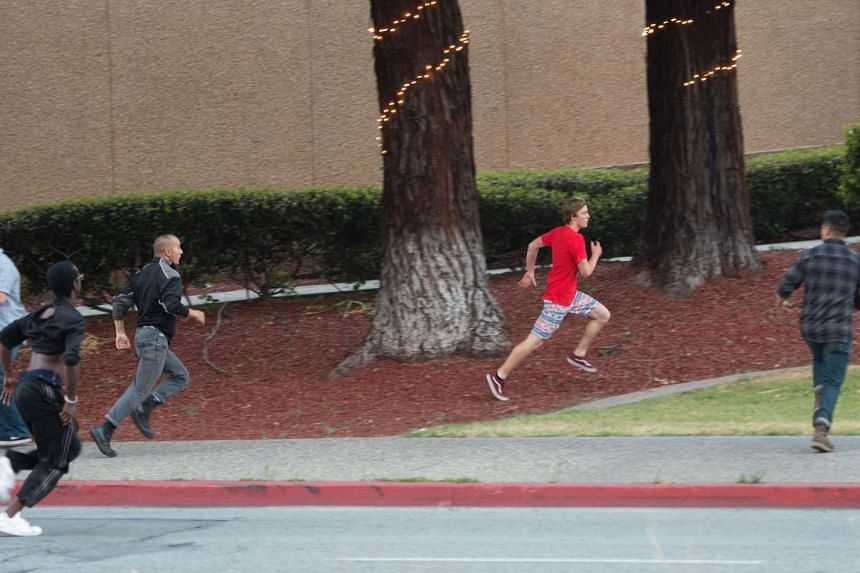 A youth (centre) wearing a Donald Trump t-shirt runs as he is chased by protesters near the venue where Republican presidential candidate Donald Trump was speaking during a rally in San Jose, California on June 2, 2016. Protesters who oppose Donald