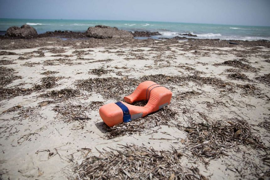 A buoyancy aid lies on a beach where bodies of migrants washed up, in Zuwarah, west of Tripoli, Libya on June 2, 2016.