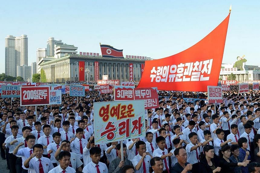 Tens of thousands of North Koreans, brandishing red flags and chanting slogans, parading through Kim Il Sung square in Pyongyang on Wednesday to celebrate the start of the regime's latest five-year economic plan.