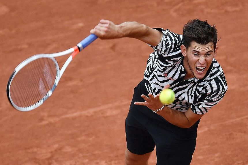 Dominic Thiem serving during his match against Belgium's David Goffin. The Austrian made it to the semi-finals of a Grand Slam tournament for the first time.