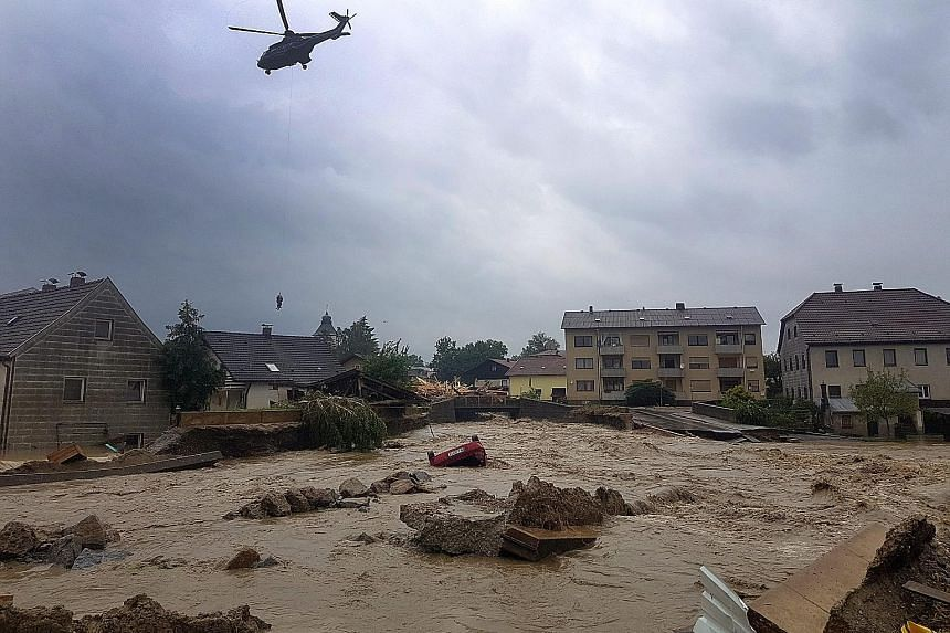 A helicopter on a rescue operation amid flooding in Simbach, Germany, on Wednesday. The death toll from torrential rainfall across northern Europe has risen to nine, and thousands of people have been evacuated. Heavy rains lashing parts of France, Ge