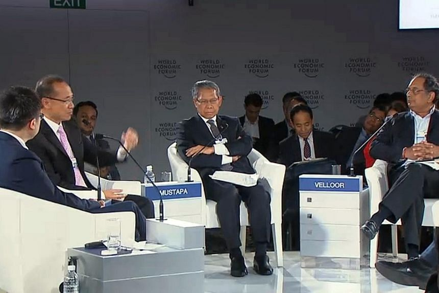 Mr George Yeo (second from left) speaking during a panel session at the World Economic Forum on Asean yesterday. The session's moderator was ST associate editor Ravi Velloor (right). The speakers included Mr Calvin Chi Kin Choi (left) and Tan Sri Mus