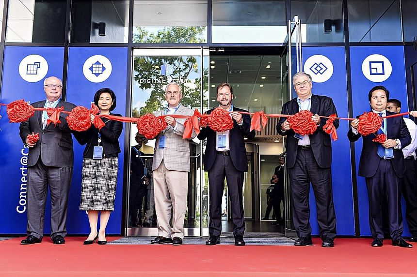 At the opening of the facility in Loyang Way yesterday were (from left) Mr Stein, Ms Thien, Digital Realty chief investment officer Scott Peterson, Digital Realty senior vice-president for acquisitions Chris Kenney, US embassy deputy senior commercia