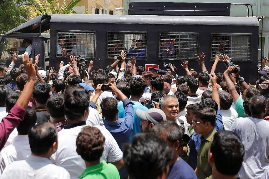 A police van transporting some of those convicted from the Ahmedabad court yesterday.