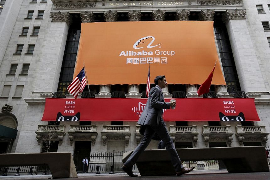 Signage for Alibaba Group Holding covers the front facade of the New York Stock Exchange.