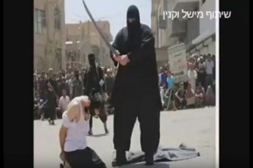 An ISIS executioner known as The Bulldozer has been captured by the Syrian Army, according to footage posted online.