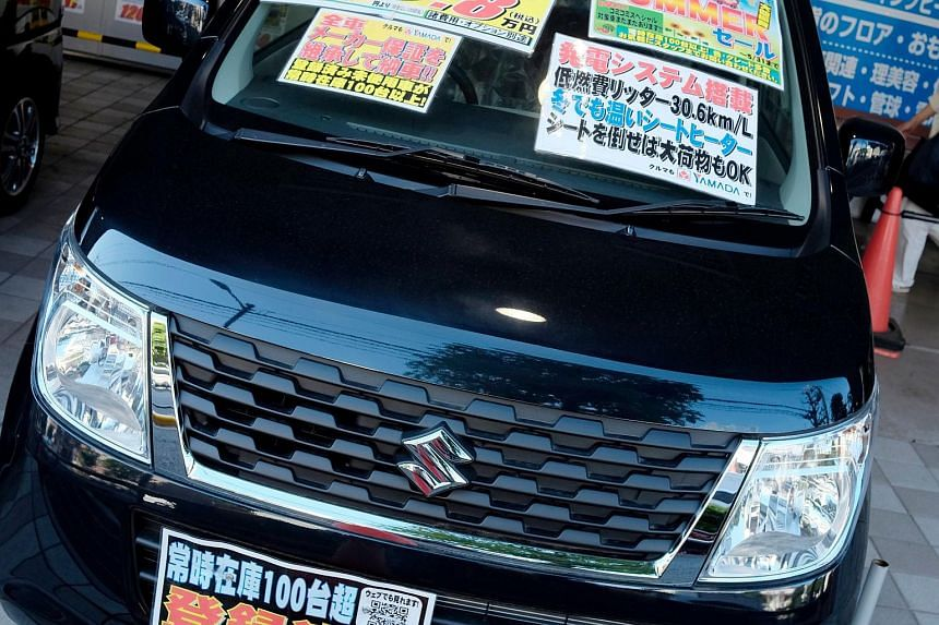 A Suzuki car displayed at a store in Tokyo on May 18.