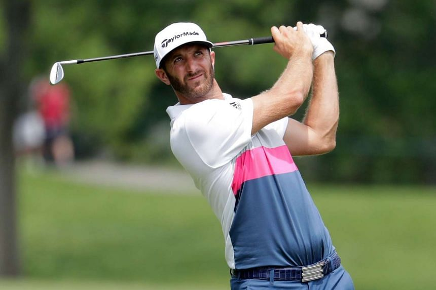 Dustin Johnson hits his second shot on the 14th hole during the first round on June 2, 2016.