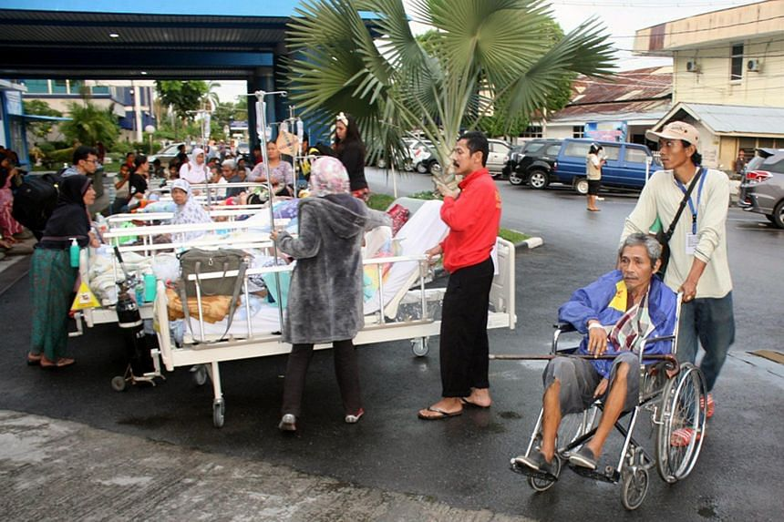 Padang residents are given medical care outside the M. Djamil Hospital after an earthquake hit near Padang, West Sumatra, Indonesia, on June 2.