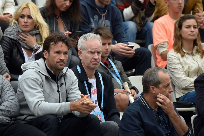 Former US tennis player John McEnroe (second from left) attends the 2016 French Tennis Open in Paris, on May 29, 2016.