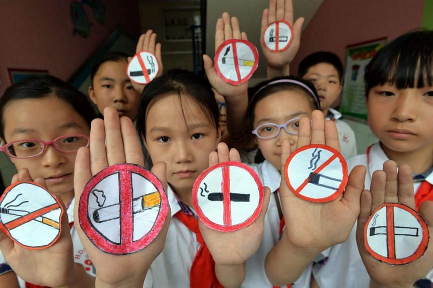Students with no smoking signs to support World No Tobacco Day at a primary school in Handan, northern China's Hebei province, on May 30, 2016.