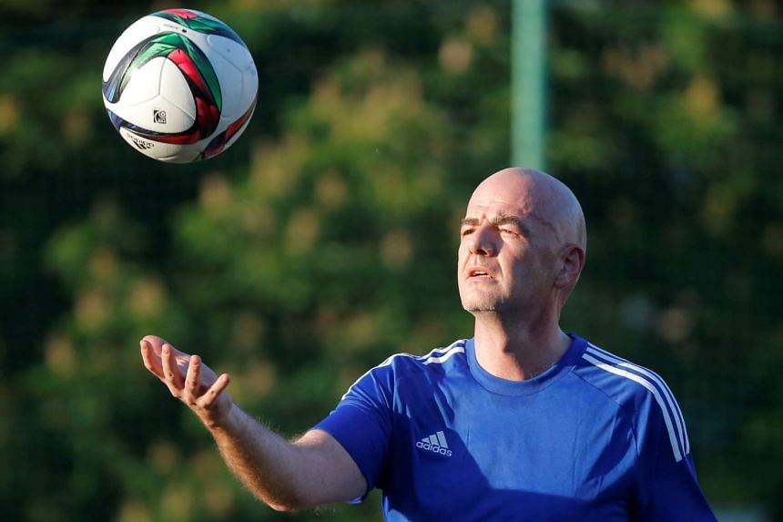 Fifa President Gianni Infantino plays with a ball during a friendly football match in Moscow, Russia, on June 1, 2016.
