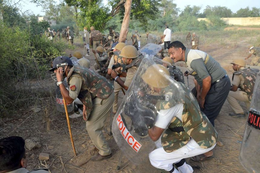 Indian police patrol during clashes with members of a sect said to have been living illegally at the Jawahar Bagh park in Mathura, on June 2, 2016.
