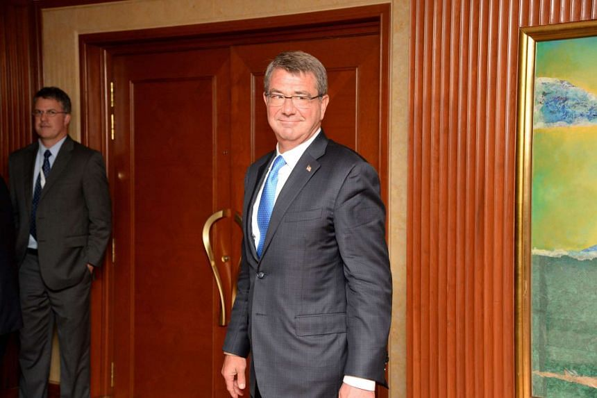 US Secretary of Defence Ashton Carter smiles after a photo session with US officials ahead of the 15th IISS Shangri-La Dialogue, on June 3, 2016.