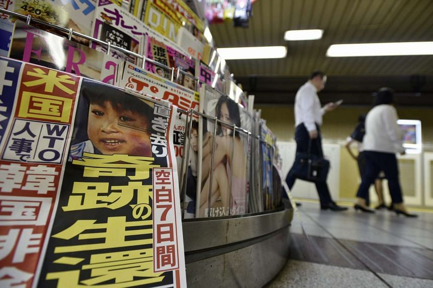 Yamato Tanooka is pictured on an evening newspaper at a subway station kiosk in Tokyo, Japan on June 3, 2016.