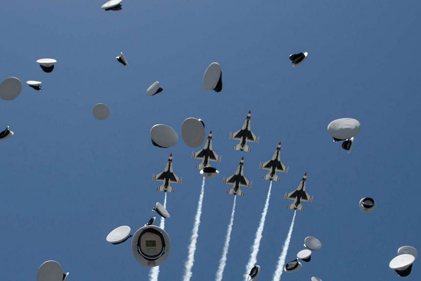 Cadets caps and Air Force Thunderbirds are seen during the graduation ceremony.