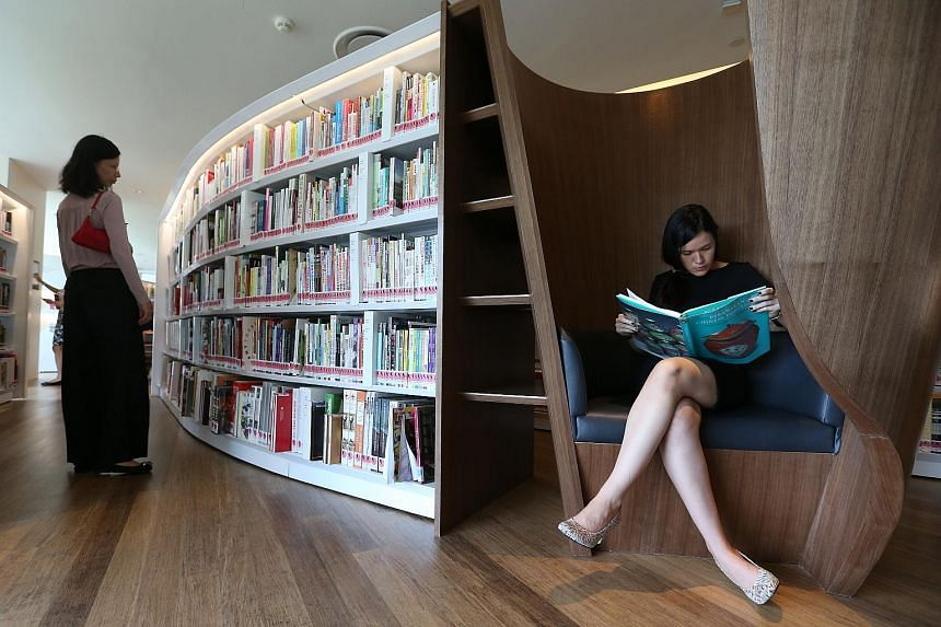 Visitors at the reading area on the second level of library@orchard.