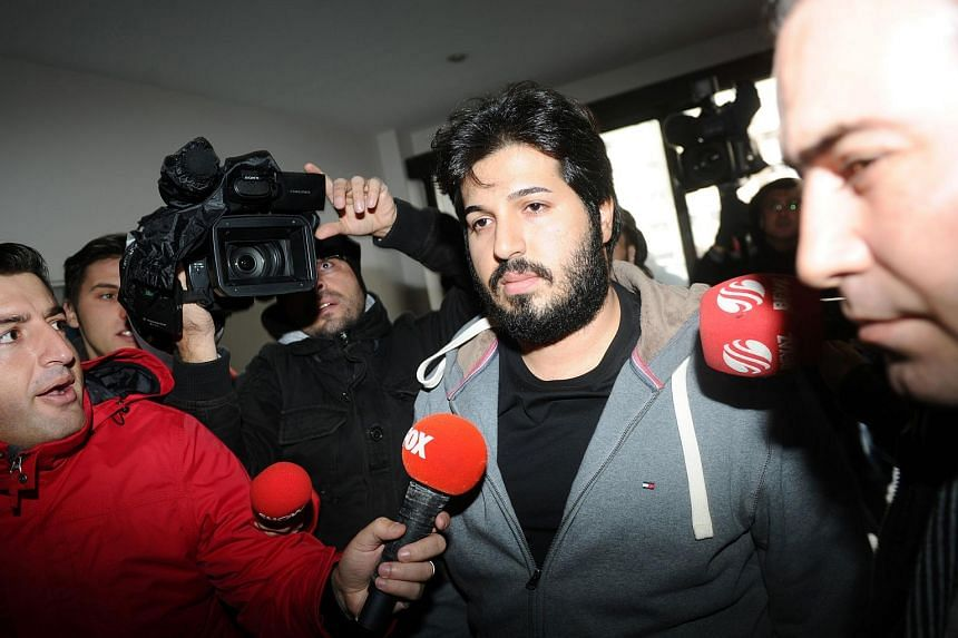 This file photo taken on Dec 17, 2013, shows Azerbaijani businessman Reza Zarrab (centre) surrounded by journalists as he arrives at a police centre in Istanbul.