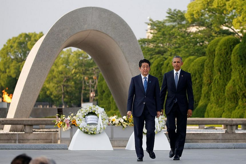 President Barack Obama (right) and Japanese Prime Minister Shinzo Abe after laying wreaths at Hiroshima Peace Memorial Park, on May 27, 2016.