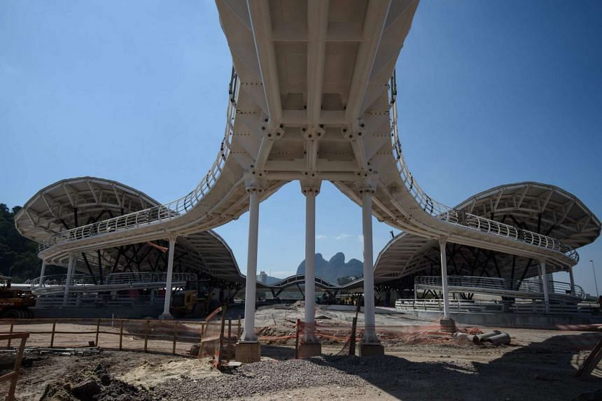 View of the construction site of the TransOlimpica highway, the Bus Rapid Transit (BRT) line system that will link the Olympic zones between Barra da Tijuca and Deodoro neighborhoods, near the Olympic park in Rio de Janeiro, Brazil, on April 8, 2016.