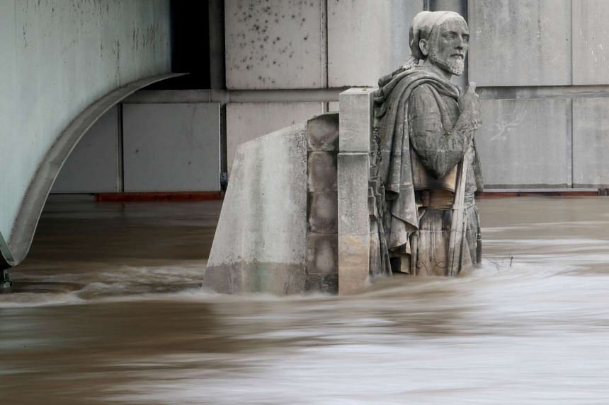 Waters of the river Seine rising on the statue of the Zouave at the Alma bridge in Paris on June 3, 2016.