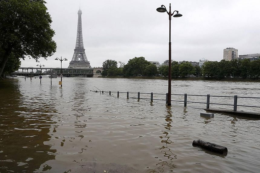 The Seine, on whose banks are found many of Paris' famous attractions such as the Eiffel Tower (in the background), the Louvre and the Musee d'Orsay, was expected to swell more than 6m above its normal level yesterday.