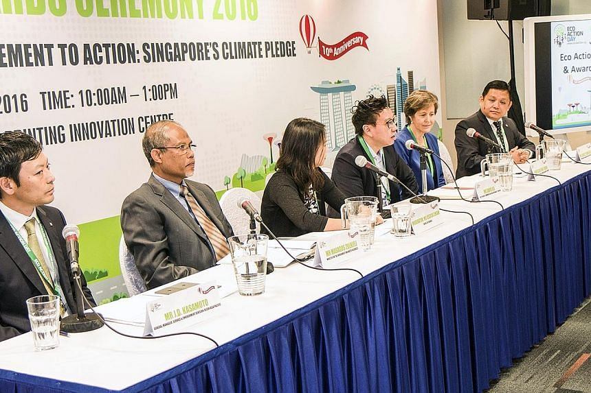 The panel yesterday included (from left) general manager of Ricoh's service and environment division J.D. Kasamoto; Minister Masagos Zulkifli; Eco-Business editor Jessica Cheam; vice-president of communications and sustainability at Unilever David Ki