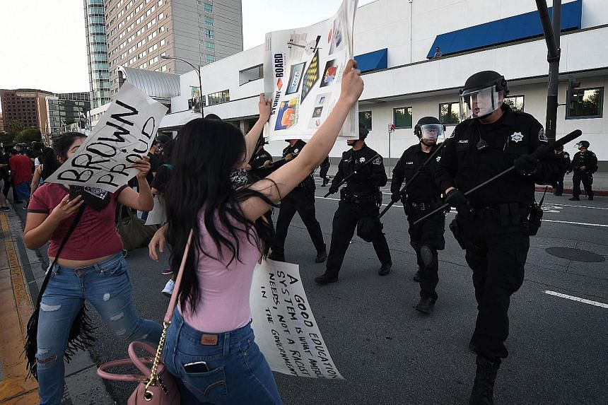 Police officers moving in to disperse anti-Trump protesters as they demonstrated outside the convention centre where Republican presidential candidate Donald Trump was holding an election rally in San Jose, California, on Thursday. Protesters who opp