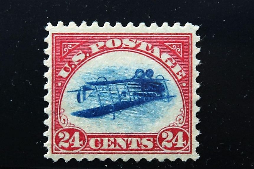 "A rare stamp, known as an ""Inverted Jenny"", on display on Thursday at the World Stamp Show in Manhattan, New York City. The stamp, one of the most famous in American history, was stolen from a display case at a convention in 1955 and was located only"
