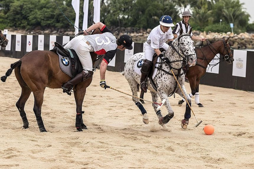 Players going head to head on Sentosa's Tanjong Beach, as part of an exhibition match for the BMW Singapore Beach Polo Championship today and tomorrow. The smaller field and soft surface make the sport tougher than the regular game.
