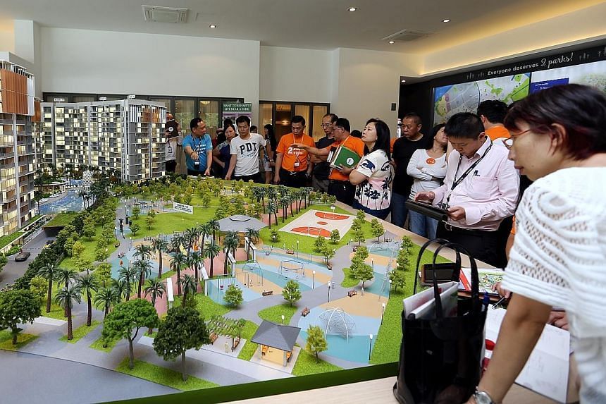 Potential buyers checking out a model of Parc Life EC in Sembawang in April. ECs are popular as they offer facilities similar to those in condominiums but at a lower price. However, there are rules for buyers and a key step is to check for eligibilit
