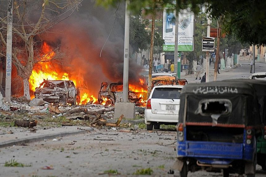 The aftermath of a terror attack on a top Mogadishu hotel by Somalia's Al-Qaeda- linked Shabaab this week.