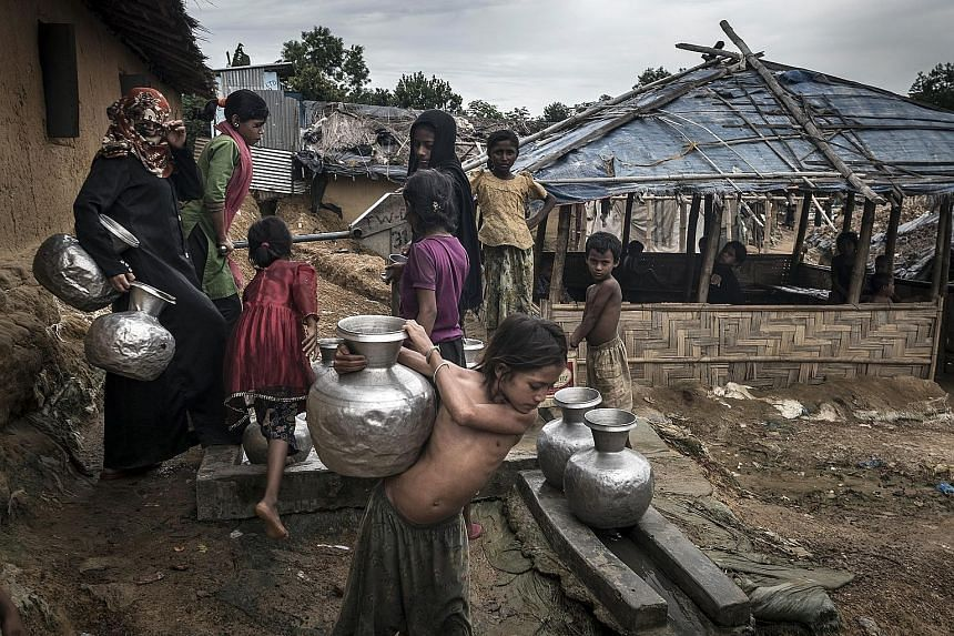 Rohingya refugees at a camp in Teknaaf, Bangladesh, in June last year. Thousands more live in makeshift camps. They are vulnerable to human traffickers and exploited as cheap labour.